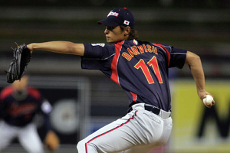 FILE - In this March 17, 2009 file photo, Japan starter Yu Darvish pitches against South Korea in the first inning of their World Baseball Classic game in San Diego. Darvish recently signed with the Texas Rangers for a contract worth more than $100 million. (AP Photo/Chris Park, File), Photo: Chris Park / AP2009