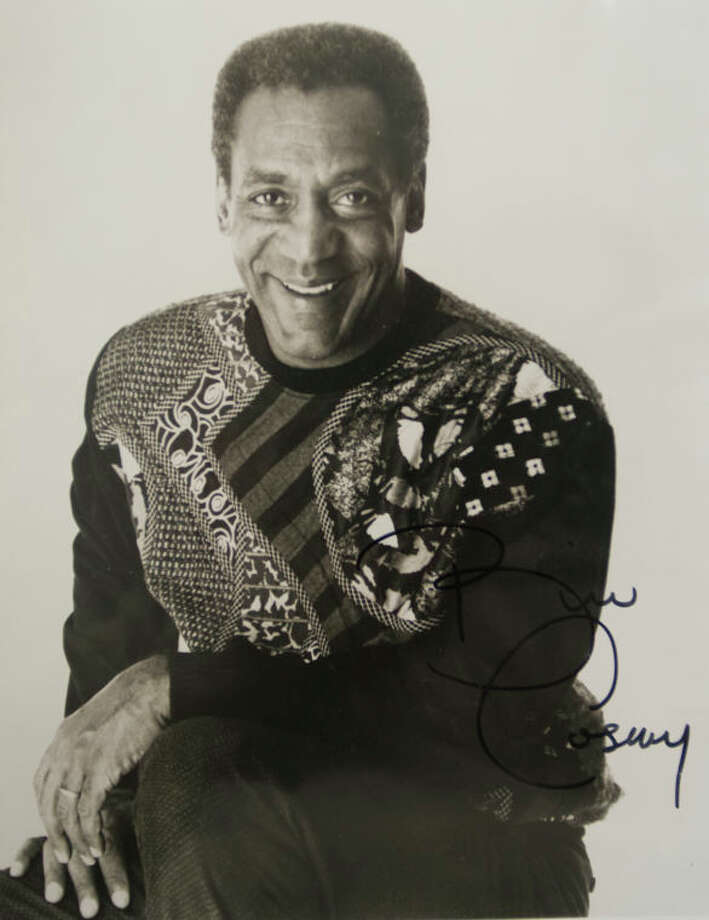 Memorabilia found in a plain black three-ring-binder on shelves at Big Brother and Big Sister office as they clean and start packing to move into their new building. Autographed picture of Bill Cosby. Tim Fischer\Reporter-Telegram Photo: Tim Fischer