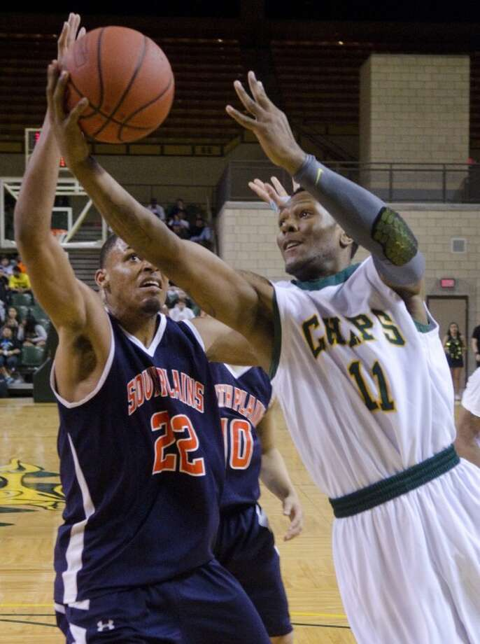 Midland College's Brandon Maclin takes the ball in as South Plains' Malcolm Miller defends Monday night at the Chap Center. Photo by Tim Fischer/Midland Reporter-Telegram Photo: Tim Fischer