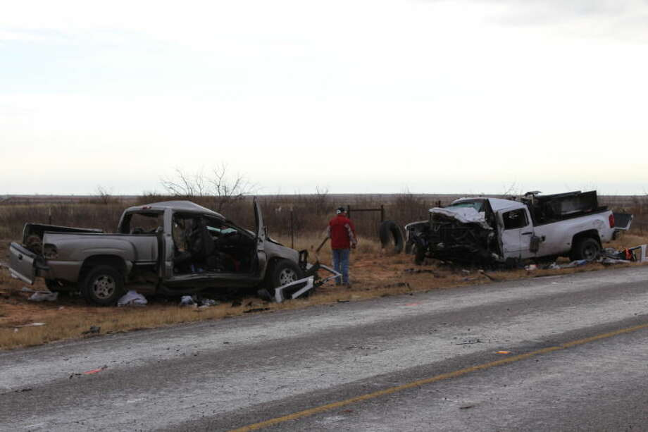 Texas Department of Public Safety troopers clean up the aftermath of a fatal two-pickup crash Tuesday morning on FM 1788. Tyler White/Reporter-Telegram Photo: Tyler White