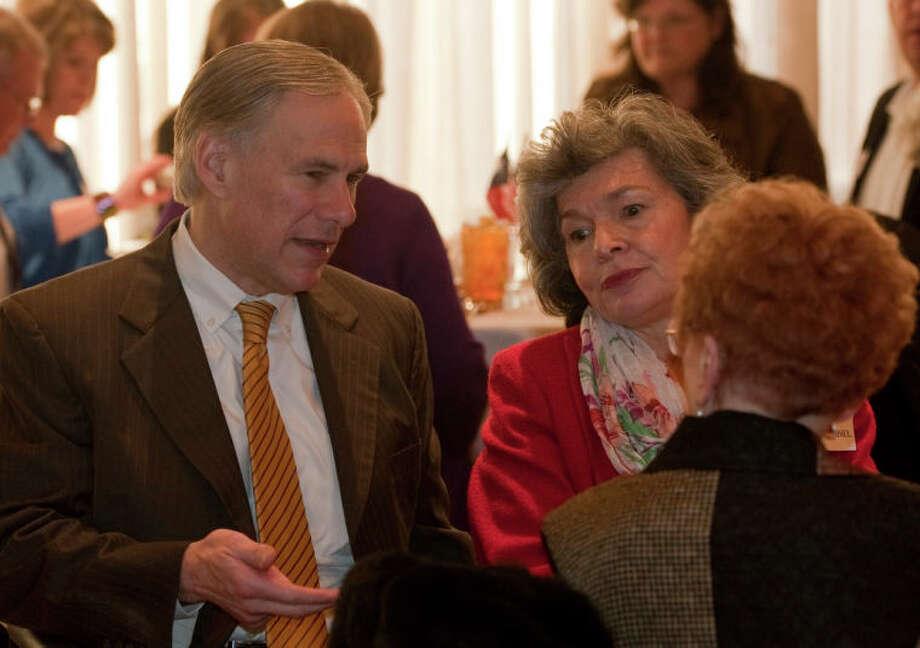 Texas attorney general Greg Abbott talks with Deanna Krehbiel, facing and Joyce Sherrod Wednesday at the Midland County Republican Women's luncheon. Tim Fischer\Reporter-Telegram Photo: Tim Fischer