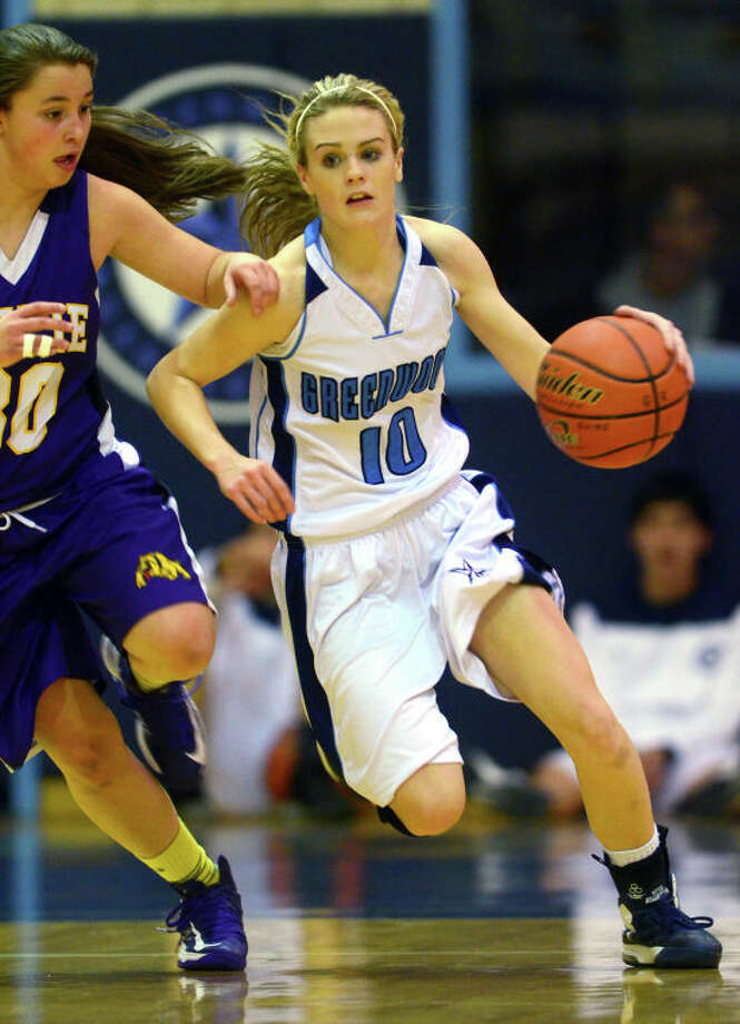 Greenwood's Ashton Hannsz runs down the court against Wylie's Taylor Rickman Tuesday at Greenwood High School. James Durbin/Reporter-Telegram Photo: JAMES DURBIN / © 2012 Midland Reporter Telegram. All Rights Reserved.