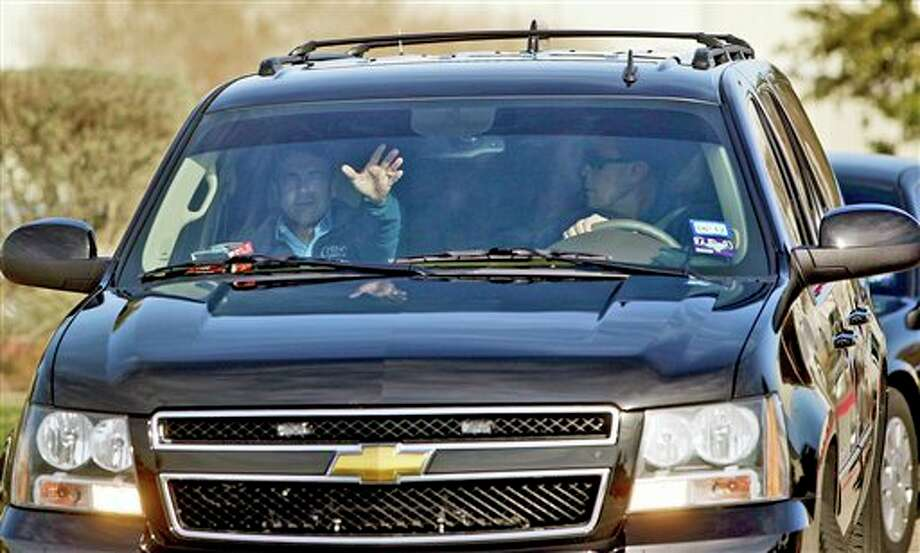 Texas Gov. Rick Perry, left, waves to reporters as he arrives in Austin, Texas, Thursday, Jan. 19, 2012. Perry on Thursday dropped out of the race for the Republican presidential nomination and endorsed Newt Gingrich. Photo: Lisa Krantz | San Antonio Express-News / @2012 SAN ANTONIO EXPRESS-NEWS