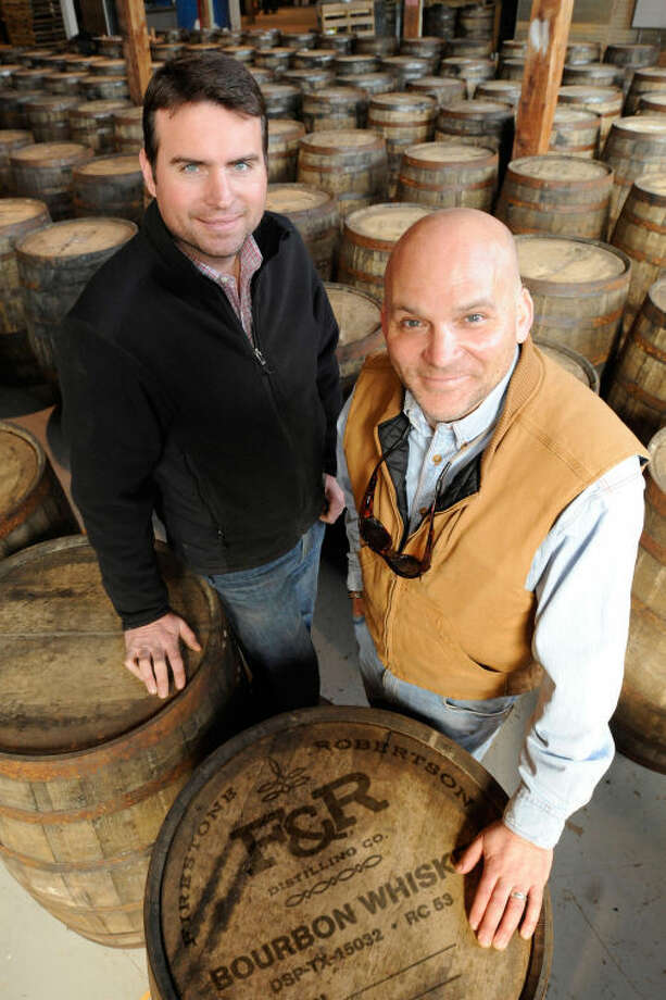 Troy Robertson, left, and Leonard Firestone make TX blended whiskey at Firestone & Robertson Distillery in Fort Worth. Photo: Courtesy Photo