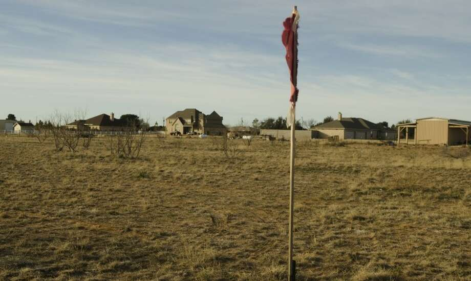 One of the flags a company has put out designating their drill site near homes off County Road 60. Residents are opposed to the sites within thier neighborhood. Photo by Tim Fischer/Midland Reporter-Telegram Photo: Tim Fischer