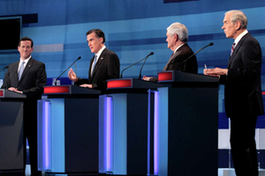 Republican presidential candidates, from left to right: former Pennsylvania Sen. Rick Santorum; former Massachusetts Gov. Mitt Romney; former House Speaker Newt Gingrich; and Rep. Ron Paul, R-Texas, stand at their podiums at the South Carolina Republican presidential candidate debate in Myrtle Beach, S.C., Monday, Jan. 16, 2012. (AP Photo/Charles Dharapak, Pool) Photo: Charles Dharapak / AP POOL