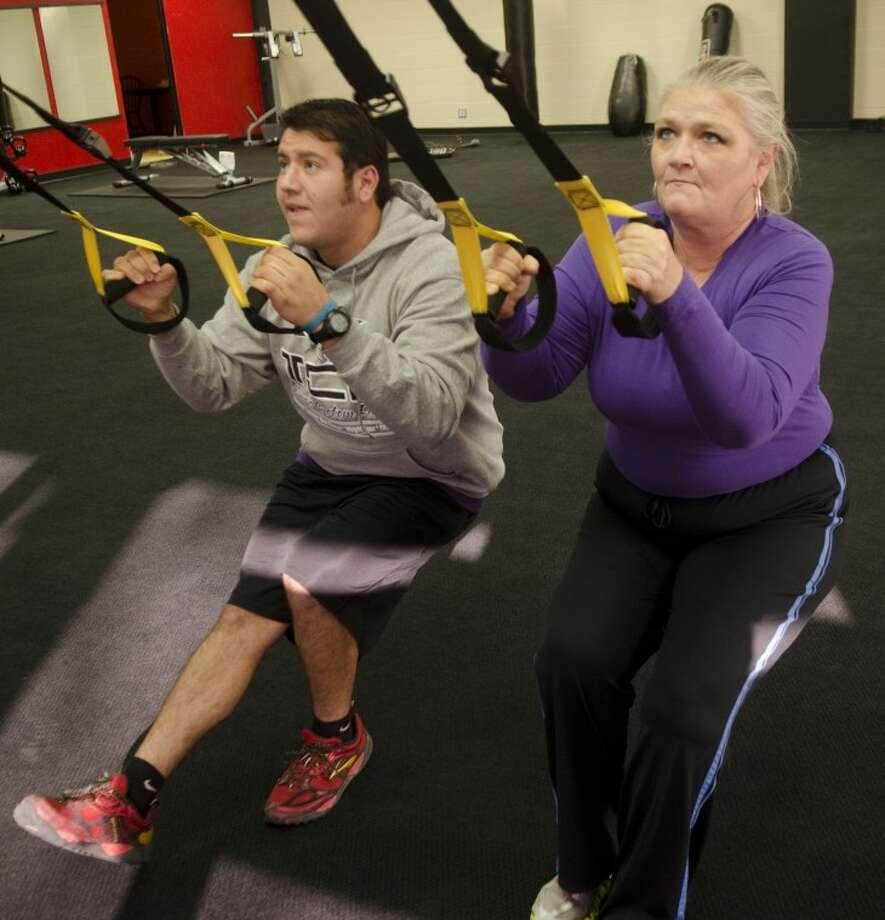 Martin Vega, trainer at Tobar's Custom Fitness, works with Terri Wayland Monday at Tobar's. Photo by Tim Fischer/Midland Reporter-Telegram Photo: Tim Fischer