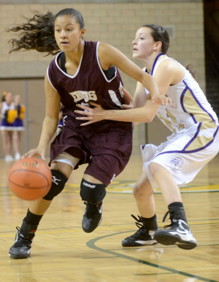 Lee's Alli Valdez dribbles around Midland's Miranda Mast Friday at Chaparral Center. Midland beat Lee 44-40. James Durbin/Reporter-Telegram Photo: JAMES DURBIN