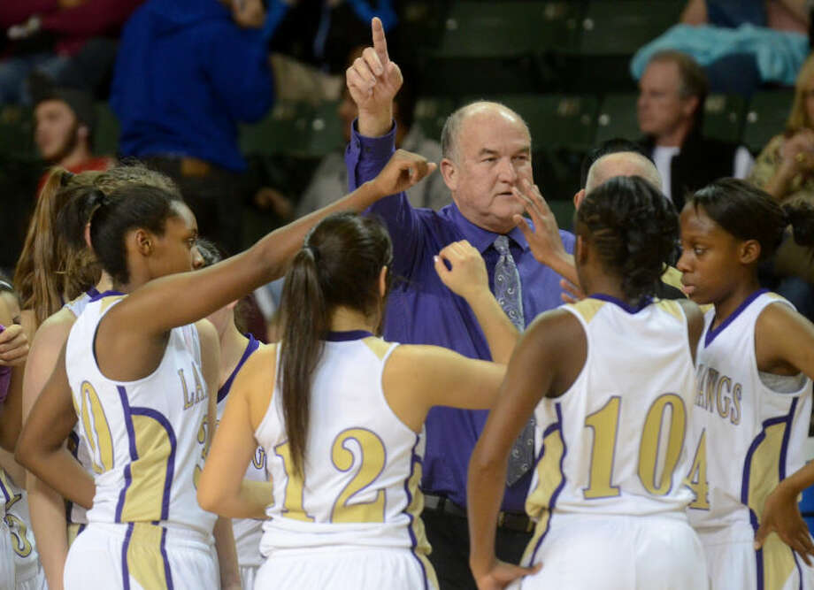 Midland girls basketball head coach Ron Berry talks to his team during a time-out in the final minute of play against Lee Friday at Chaparral Center. Midland beat Lee 44-40. James Durbin/Reporter-Telegram Photo: JAMES DURBIN