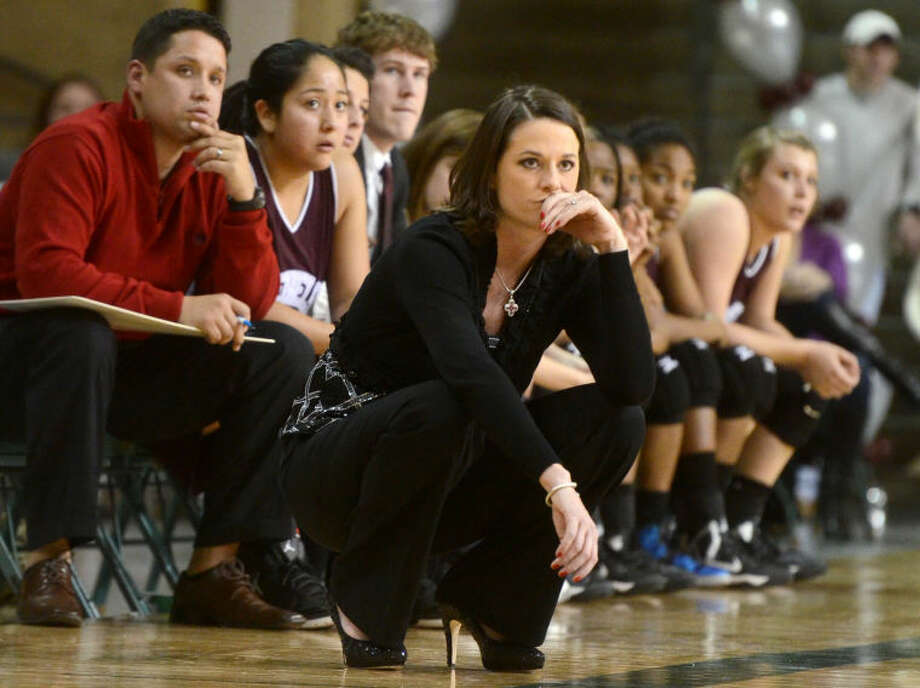 From January 2012 to May 2013, 10 head coaches in Midland ISD resigned from their respective posts. But none of the 10 were as controversial as the departure of Morgan Fowler.Fowler took over the Lee girls basketball program as a first-time head coach on June 25, 2012. During what turned out to be her only season with the program, she guided the Lady Rebels to their first winning season since 2007-08, finishing 15-14 after falling to El Paso Franklin in the bi-district round of the playoffs.But less than four months after that season-ending loss to Franklin, Fowler unexpectedly tendered her resignation to MISD athletic director Todd Howey on May 21.Upon publishing the story on Fowler's resignation on www.mrt.com, it received 32 comments within a 48-hour period with some readers condemning Fowler while others defended her.Two days after Fowler's resignation, MRT sports writer Jonathan Hull posted a column online addressing some of the rumors stemming from Fowler's dismissal, including whether some parents took steps to call for her removal. The column only added more heat to a controversy that ended up being the most commented on sports story of the year on www.mrt.com with 60 comments.Many of the rumors stemmed from Fowler's high-intensity style with some parents taking exception with the way the enigmatic coach screamed at her players during games and practices.Fowler was replaced by 1989 Lee grad Monica Ramirez, who previously coached at El Paso El Dorado for two seasons before returning to coach her alma mater on June 6.Fowler has at least temporarily left the coaching profession and moved to the Houston area with her husband, Matt. Photo: JAMES DURBIN
