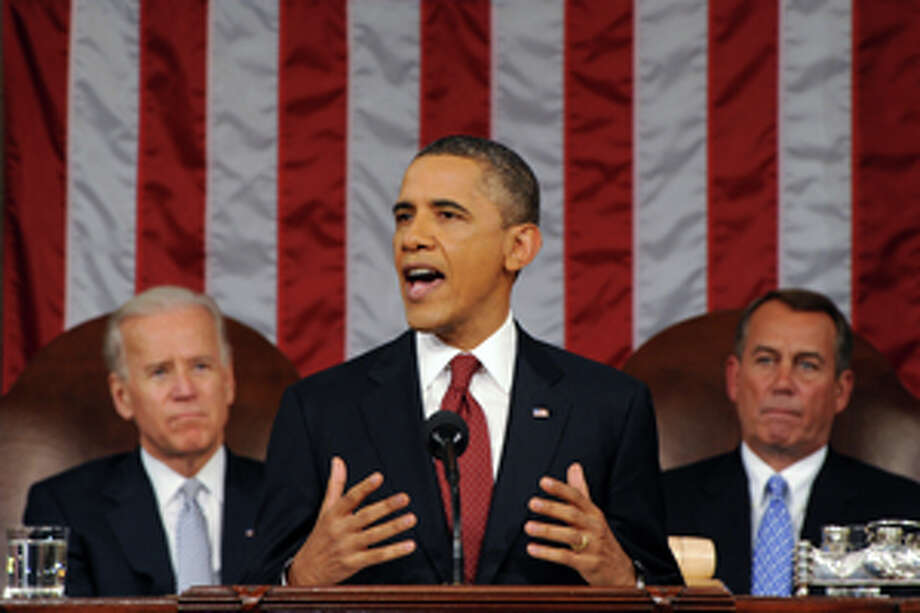President Barack Obama delivers his State of the Union address on Capitol Hill in Washington, Tuesday, Jan. 24, 2012. Listen in back are Vice President Joe Biden and House Speaker John Boehner, right. Photo: Saul Loeb/AP / Pool AFP