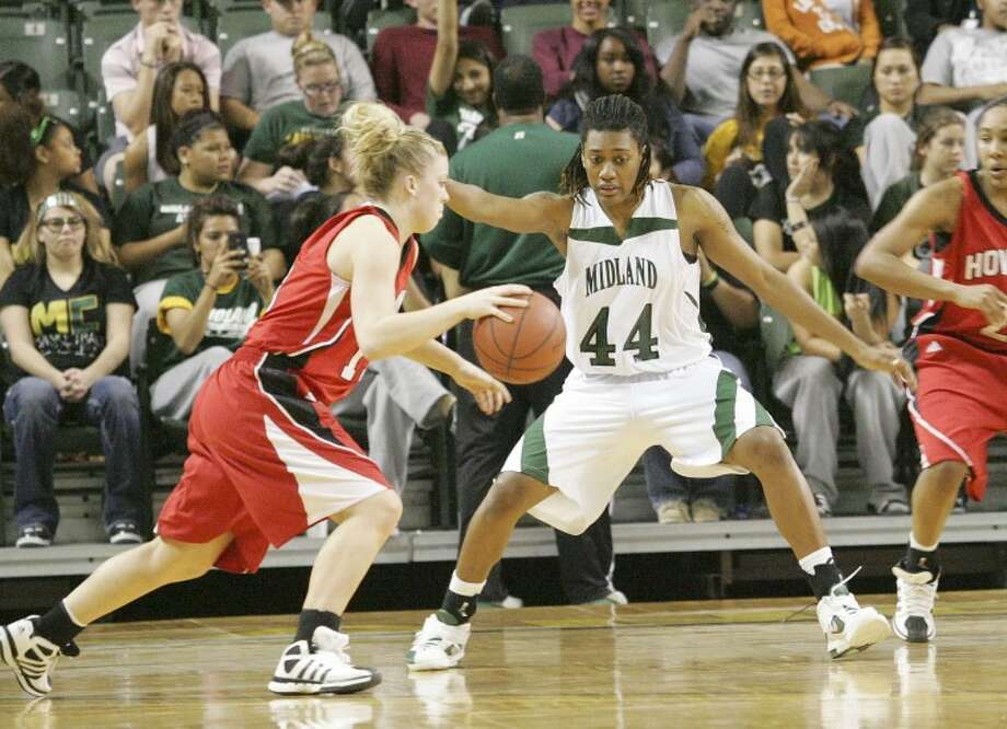 Midland College's Achiri Ade (44) guards Howard College's Tori Tucker (13) earlier this season at Chaparral Center. Cindeka Nealy/Reporter-Telegram Photo: Cindeka Nealy