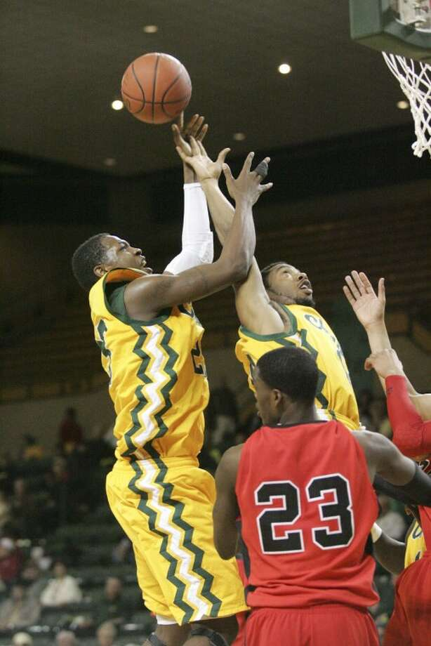 Midland College's Anthony Norris (23) and Brandon Lucas (25) attempt to rebound the ball against Howard College last Monday at the Chaparral Center. Cindeka Nealy/Reporter-Telegram Photo: Cindeka Nealy