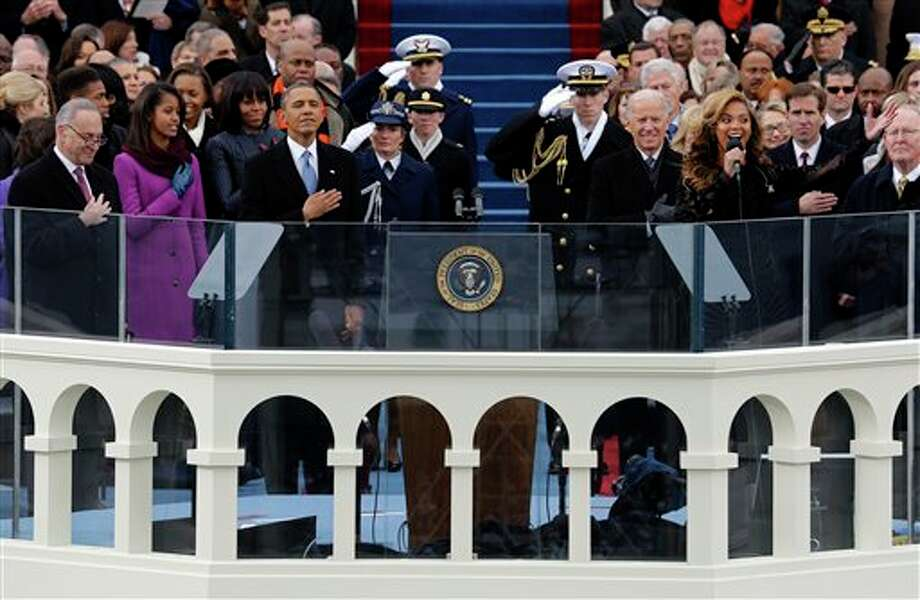 President Barack Obama, left and Vice President Joe Biden listen as singer Beyonce sings the National Anthem at the ceremonial swearing-in on the West Front of the U.S. Capitol during the 57th Presidential Inauguration in Washington, Monday, Jan. 21, 2013. (AP Photo/Scott Andrews, Pool) Photo: Scott Andrews Pool / AP2013
