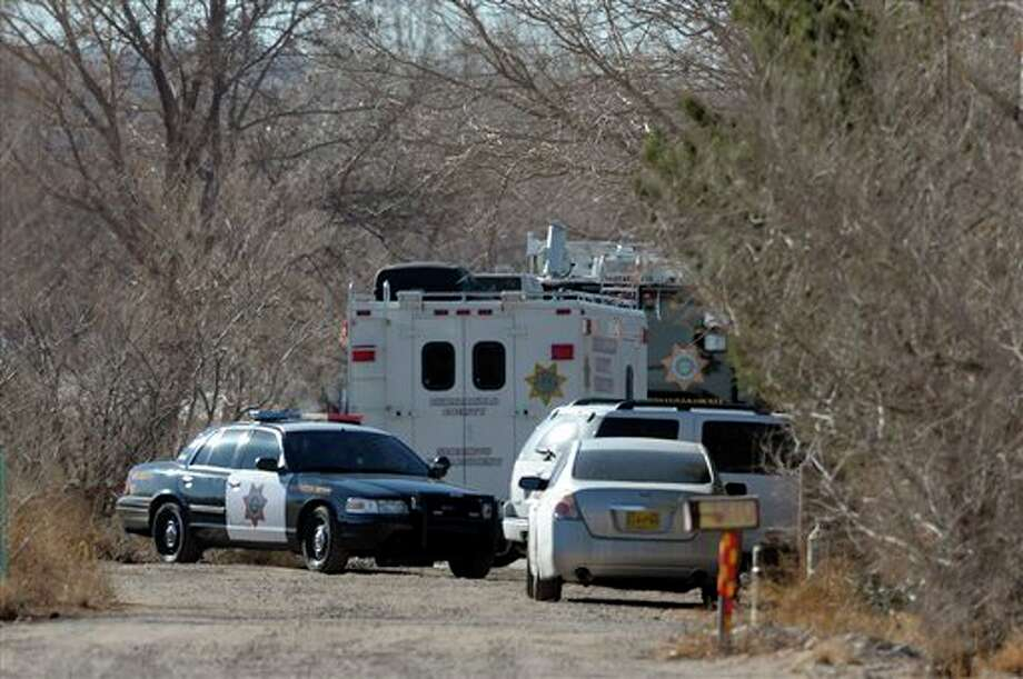 BCSO Deputies and crime scene personnel work the scene of a five person homicide in Albuquerque, NM, Sunday Jan. 20, 2013. Authorities said a teenage boy fatally shot two adults and three children at a home near Albuquerque. (AP Photo/Albuquerque Journal, Pat Vasquez-Cunningham) Photo: Pat Vasquez-Cunningham / Albuquerque Journal