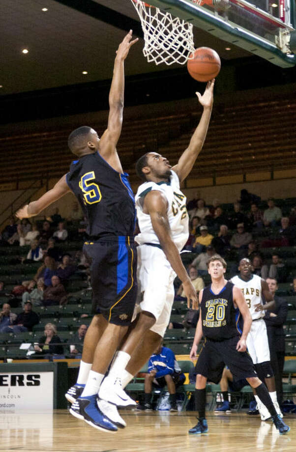 Midland College's Colan Weasby puts a layup past Frank Phillips College's Emmanuel Johnson Thursday at Chaparral Center James Durbin/Reporter-Telegram Photo: JAMES DURBIN