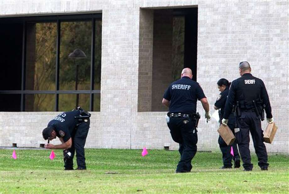 Police collect evidence after a shooting happened on Lone Star College North Harris campus on Tuesday January 22, in Houston. The shooting at a community college wounded three people Tuesday and sent some students fleeing for safety while others with medical training helped tend the wounded. (AP Photo/ Patric Schneider) Photo: Patric Schneider / AP2013