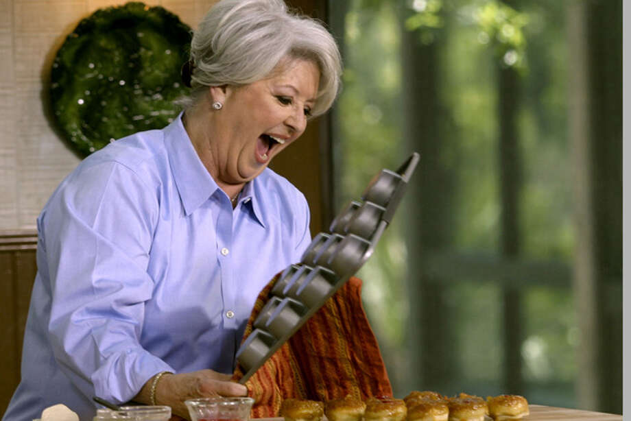 FILE- This undated file photo courtesy of Food Network shows celebrity chef Paula Deen. Deen recently announced that she has Type 2 diabetes. While Deen has cut out glass after glass of sweet tea and taken up treadmill walking off camera, she plans few changes on the air. (AP Photo/Food Network, File) Photo: Anonymous / AP2006