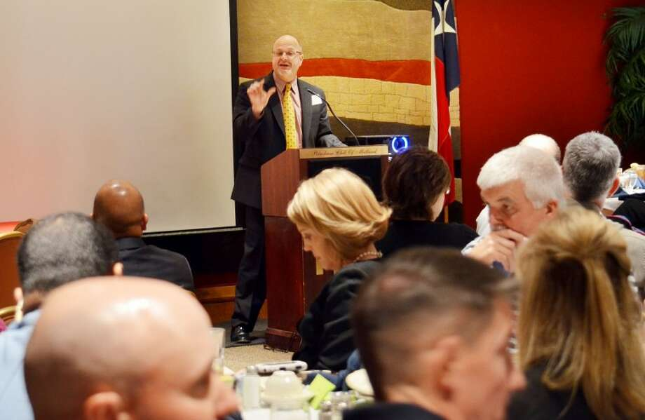 Assistant U.S. Attorney John Klassen lectures local law enforcement agents about new digital tools available to investigate suspects Friday during the 28th Midland Crime Stopper's annual awards luncheon. Photo: James Cannon/Reporter-Telegram