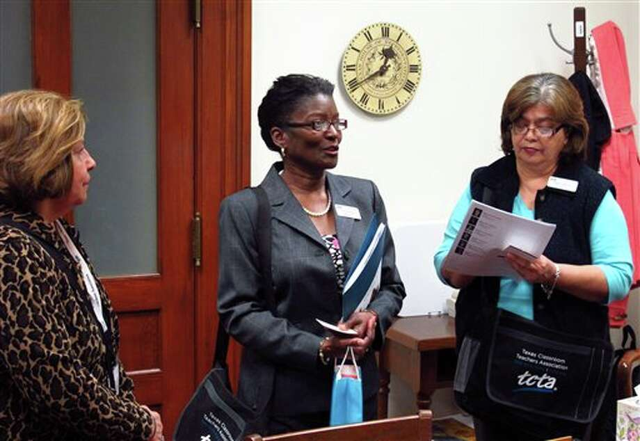 """From left, teachers Ruby Tanguma, Janie Baszile and Ella Vargas discuss school funding and other issues with a member of the staff of state Rep. Craig Eiland, D-Texas City, at Eiland's state Capitol office in Austin, Texas, on Thursday, Jan. 24, 2013. During their annual """"lobbying day"""" members of the Texas Classroom Teachers Associatoon met with lawmakers from around the state, but, nearby, a coalition of civic leaders and foundations proposed a different set of school reforms. (AP Photo/Will Weissert) Photo: Will Weissert / AP"""