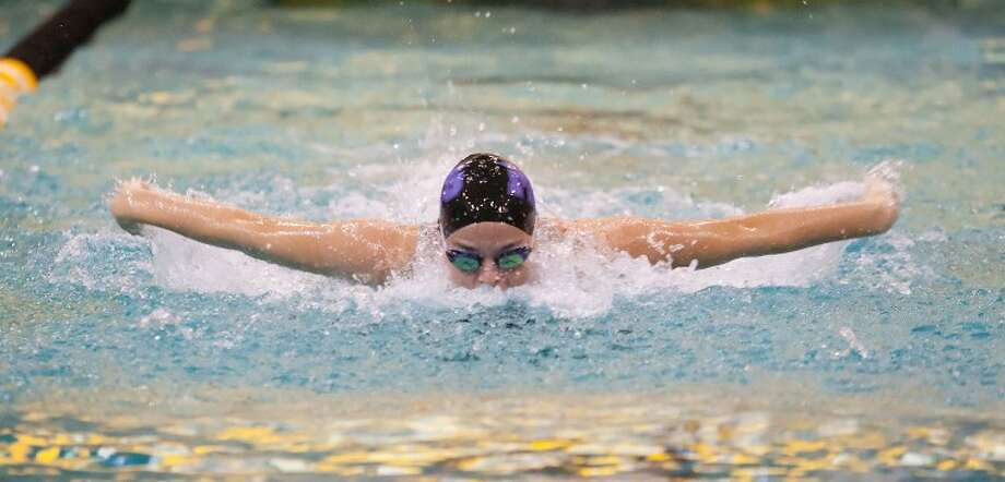 Jordin Newman competes in the 100-yard butterfly on Nov. 12 during the MISD Swimming Invitational at the Mabee Aquatic Center. Cindeka Nealy/Reporter-Telegram Photo: Cindeka Nealy
