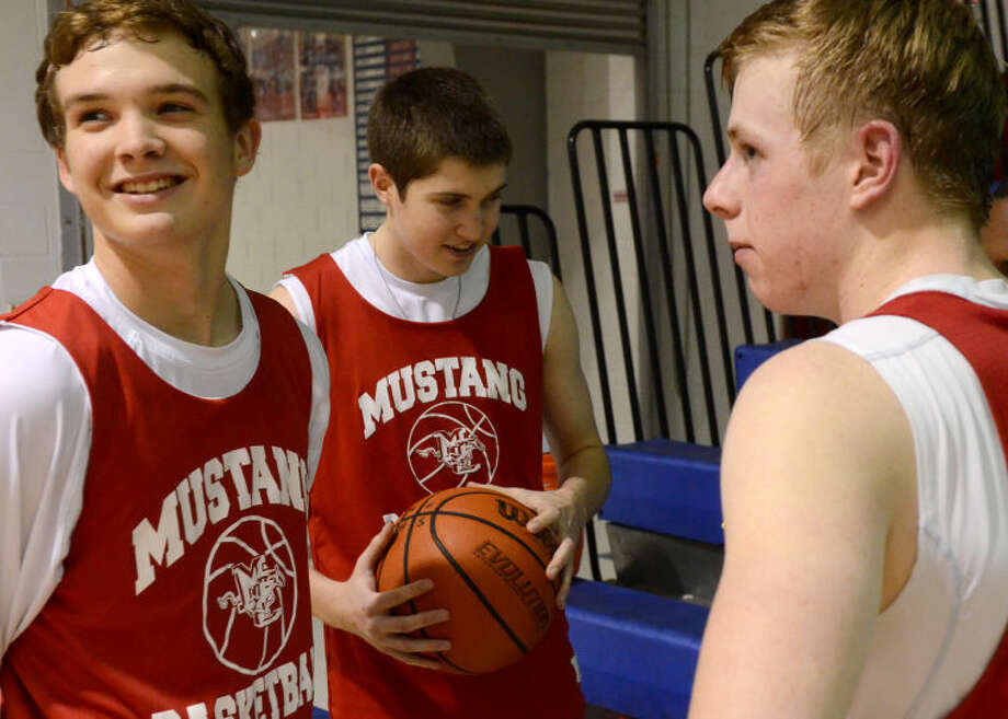 From left, Midland Christian guards Grant Little, Zach Gilbert and Mason McClendon speak with an MRT reporter during team practice Thursday at the Midland Christian gym. James Durbin/Reporter-Telegram Photo: JAMES DURBIN