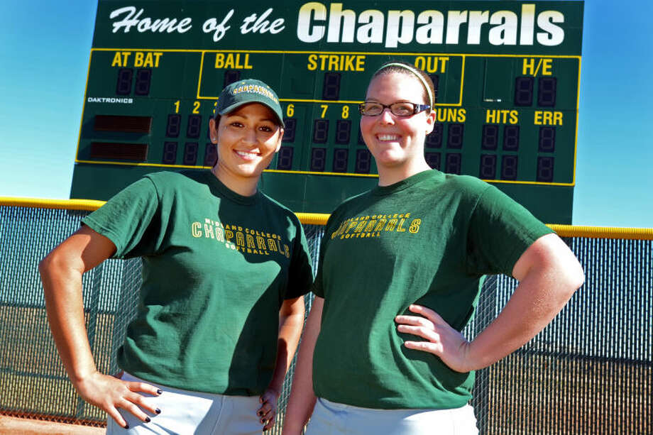 Midland College softball pitchers Kristine Vargas (left) and Holly Herrington (right) pose for a portrait on the softball field before practice Wednesday. Both pitchers are returning from last year's team. James Durbin/Reporter-Telegram Photo: JAMES DURBIN