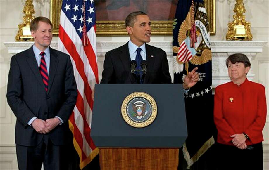 President Barack Obama announces in the State Dining Room of the White House in Washington, Thursday, Jan. 24, 2013, that he will nominate Mary Joe White, right, to lead the Security and Exchange Commission (SEC), and re-nominate Richard Cordray, left, to lead the Consumer Financial Protection Bureau, a role that he has held for the last year under a recess appointment. (AP Photo/Carolyn Kaster) Photo: Carolyn Kaster / AP2013
