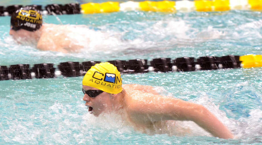 Kyle Martin (foreground) and Josh James (background), both of the COM Aquatics swim team, compete in the 200 Yard Butterfly event during the 2013 Syntal Capital Partners Winter Invite earlier this month at COM. Martin won the event with a time of 1:16.4. James Durbin/Reporter-Telegram Photo: JAMES DURBIN