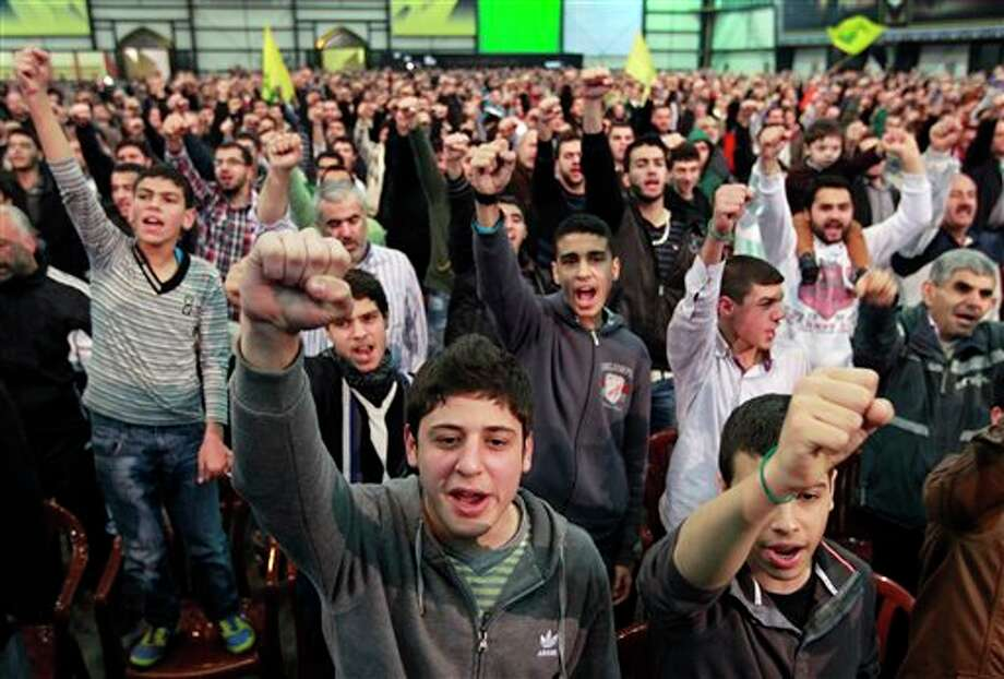 "Hezbollah supporters cheer as they listen to a speech by Hezbollah leader Hassan Nasrallah, during a ceremony to mark Islam's Prophet Muhammad's birth in the southern suburbs of Beirut, Lebanon, Friday, Jan. 25, 2013. Nasrallah, a staunch ally of the Syrian regime, said those who had dreamed about ""dramatic changes"" taking place in Syria should let go of their dreams. He said all military, political and international indications showed that President Bashar Assad's regime cannot be defeated. (AP Photo/Bilal Hussein) Photo: Bilal Hussein / AP"