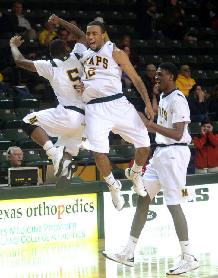Midland College's Willis Nicholson (5) and Corey Hilliard (12) celebrate a win against New Mexico Thursday at Chaparral Center. James Durbin/Reporter-Telegram Photo: JAMES DURBIN