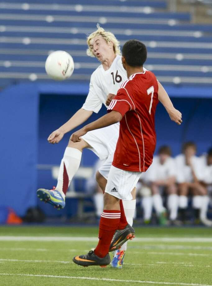 Lee's Trent Johnston (16) kicks the ball away from Odessa's Kevin Galindo (7) Tuesday at Grande Communications Stadium. Photo: Cindeka Nealy