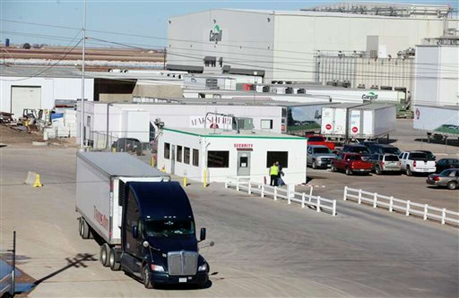 A truck leaves the Cargill beef processing plant in Plainview, Texas, Thursday, Jan. 17, 2013. Cargill announced on Thursday that it will idle the plant and lay off all 2,000 workers because of a tight cattle supply following years of drought. The company said workers in Plainview will be let go Feb. 1, and plants in Friona, Texas, Dodge City, Kan., and Fort Morgan, Colo., will get cattle that previously would have been sent to Plainview. (AP Photo/The Avalanche-Journal, Stephen Spillman) ALL LOCAL TV OUT Photo: Stephen Spillman / Lubbock Avalanche-Journal