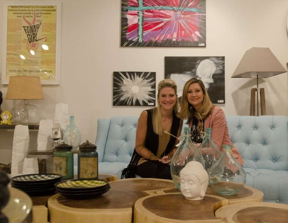 Brooke Mayes and Melissa Morehead sit in one of the room designs in their new interior design store, Blackbird Interior Designs. Photo by Tim Fischer/Midland Reporter-Telegram Photo: Tim Fischer