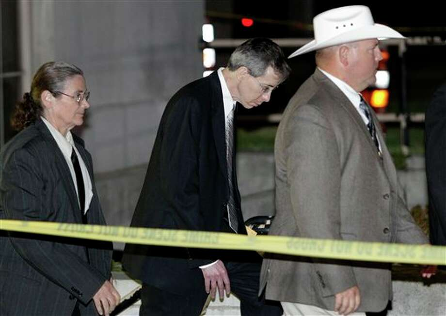 "Polygamist religious leader Warren Jeffs, center, is escorted out of the Tom Green County Courthouse Tuesday, Aug. 2, 2011, in San Angelo, Texas. A West Texas jury has heard audio recordings and diary accounts of Jeffs teaching his 14-year-old ""spiritual wife"" how to please him sexually. (AP Photo/Tony Gutierrez) Photo: Tony Gutierrez / AP"