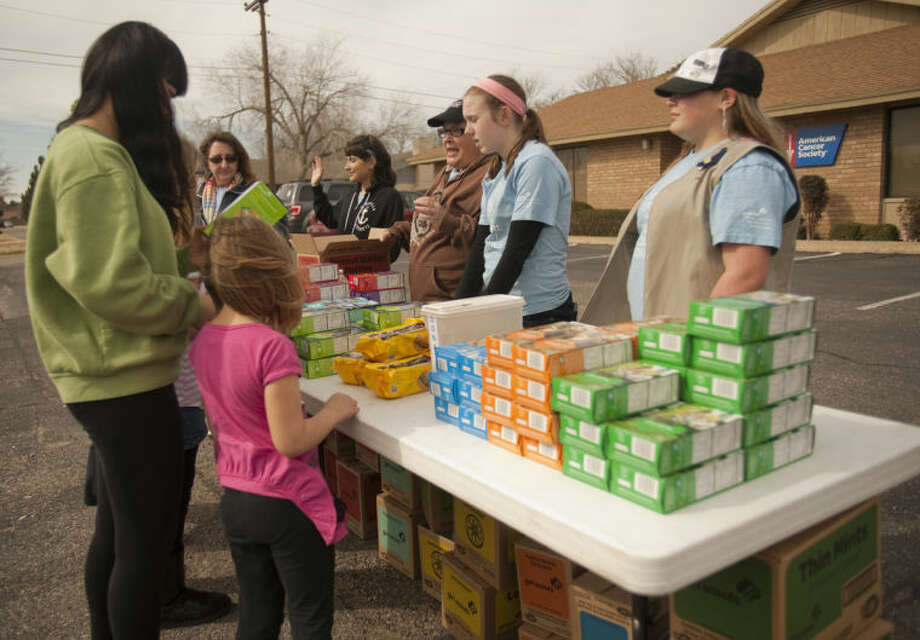 Members of Girl Scout Troop 423 sell cookies Saturday afternoon outside the American Cancer Society building on Wadley Avenue. Tim Fischer\Reporter-Telegram Photo: Tim Fischer