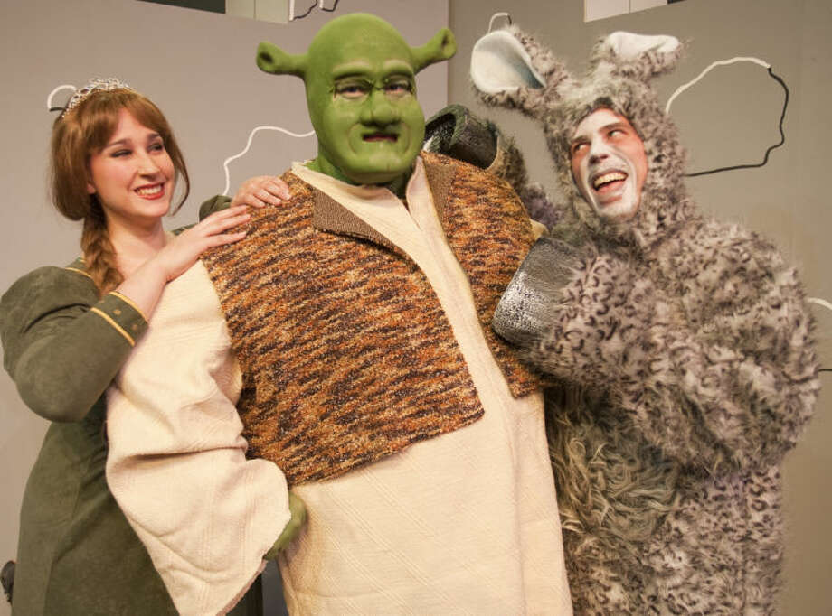 Fiona, Emily Bourland, Shrek, Scott Windham and Donkey, Justin Tate, in the Midland Community Theaters production of Shrek. Tim Fischer\Reporter-Telegram Photo: Tim Fischer