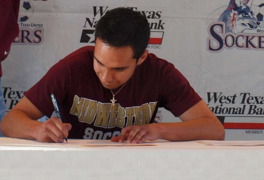 Lee soccer player Derek Sanchez signs with Midwestern State on Wednesday at the Diamond Club at Citibank Ballpark.
