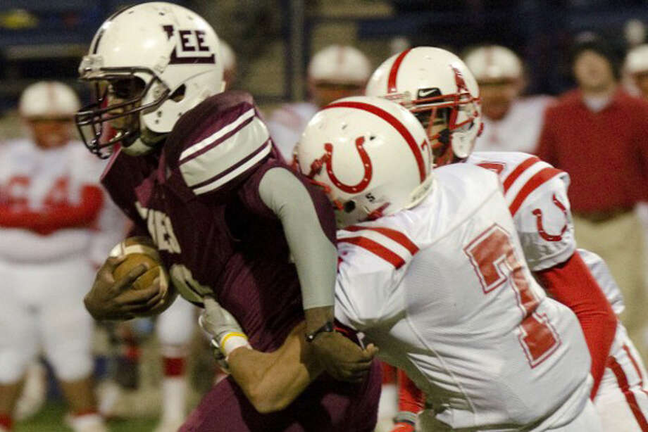 Lee High's Jason McAfee tries to gain some extra yards Nov. 4, 2011 as he drags Odessa High's Austin Tavarez  at Grande Communications Stadium. Photo: Tim Fischer | Midland Reporter-Telegram
