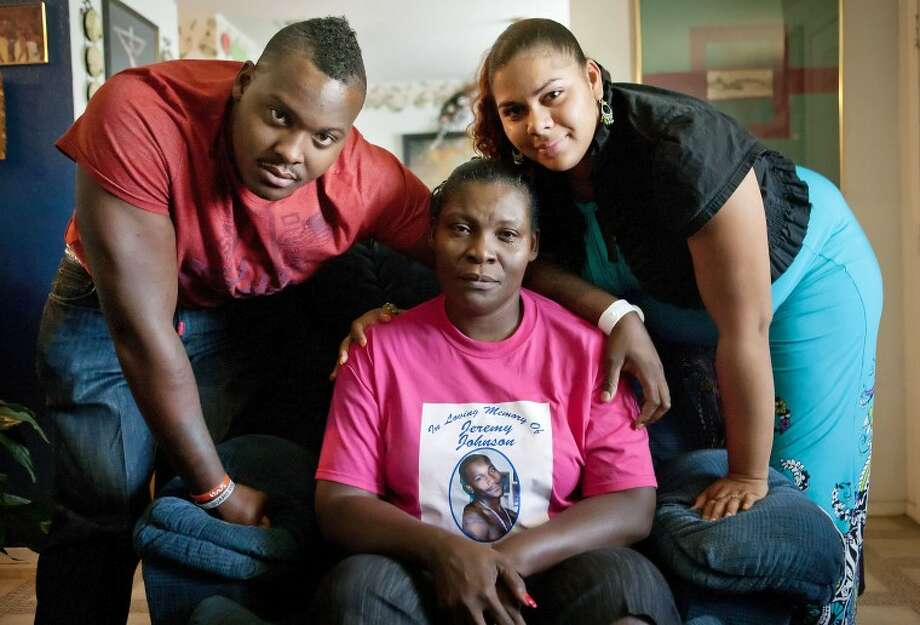 (File Photo) Brad Graves and his wife Crystal along with their mother Lavonda Johnson remember their brother and son Jeremy Johnson who was murdered on Sept. 18. Longtime family friend Christopher Hill has been charged with Johnson's murder. Cindeka Nealy/Reporter-Telegram Photo: Cindeka Nealy