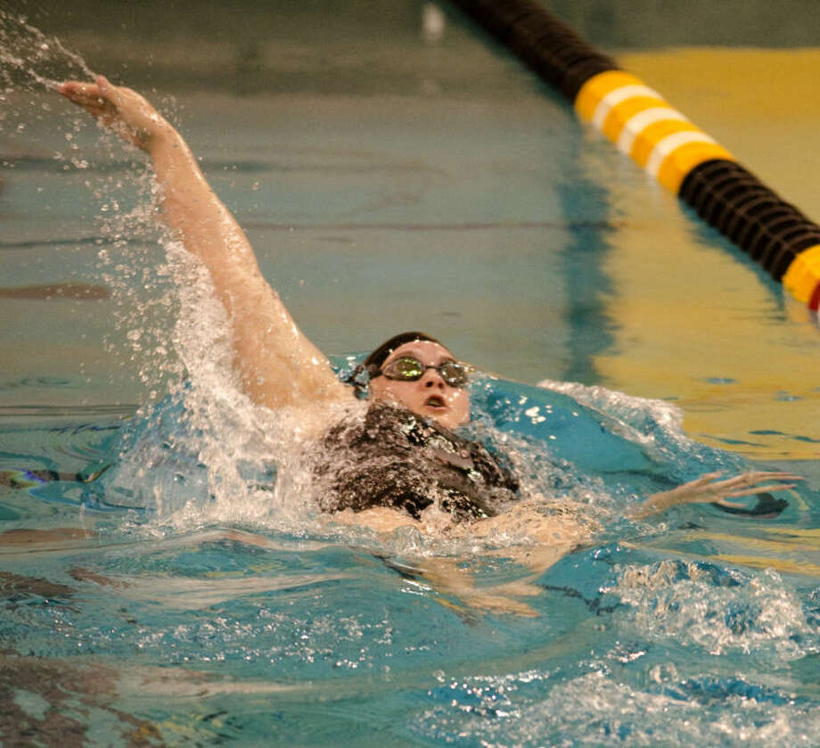 Blythe Lary swims the back stroke in the girls 200 yard medley relay Saturday at a district meet at Mabee Aquatic Center. Tim Fischer\Reporter-Telegram Photo: Tim Fischer