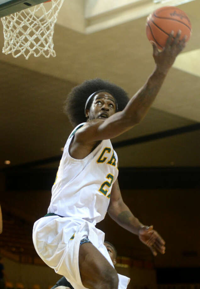 Midland College's Justin Coleman scores against New Mexico Military Institute Thursday at Chaparral Center. James Durbin/Reporter-Telegram Photo: JAMES DURBIN