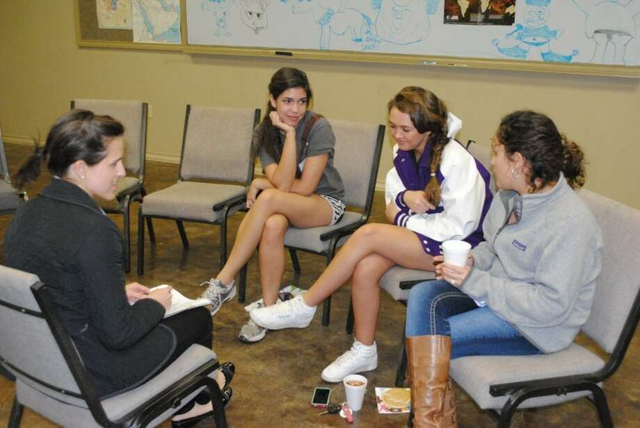 From left, Ansley Craine leads a core group of Samantha Foster, Kalli Dixon and Kim Molina Jan. 23, during Teen Community Bible Study at Midland Bible Church. Photo: Rachel Eyler