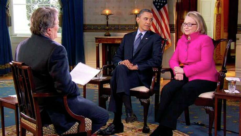 "FILE - In this Jan. 25, 2013 file image taken from video and provided by CBS, President Barack Obama, center, and Secretary of State Hillary Rodham Clinton speak with ""60 Minutes"" correspondent Steve Kroft, left, in the Blue Room of the White House in Washington. The interview will air Sunday, Jan. 27 during the ""60 Minutes"" telecast on CBS. (AP Photo/CBS, File) Photo: Uncredited / CBS"