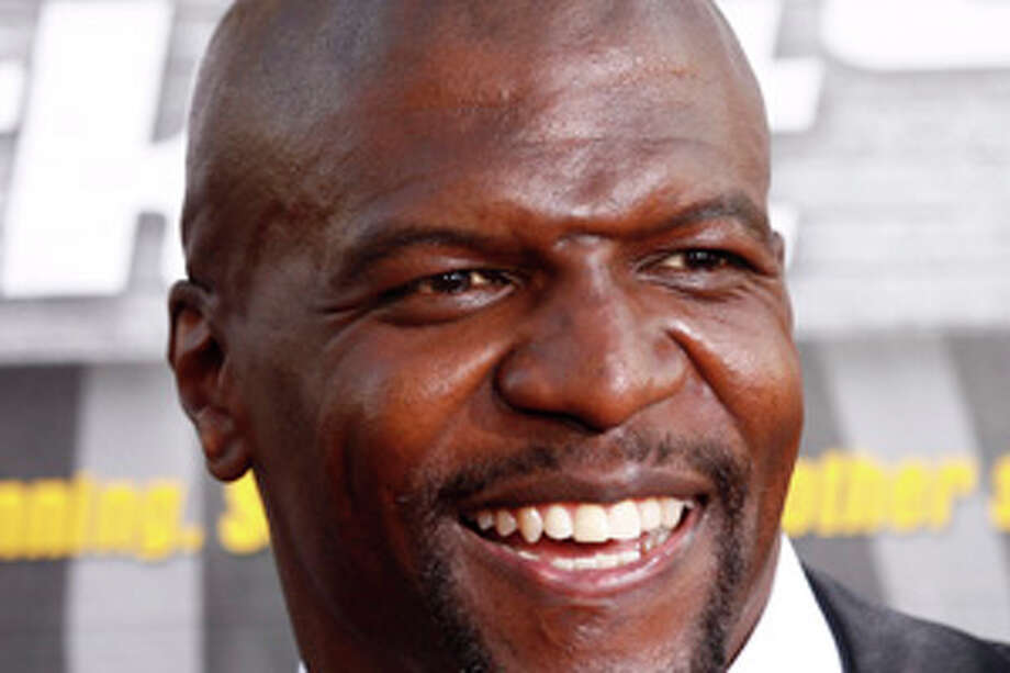"FILE - In this Aug. 12, 2010 file photo, athlete-turned-actor Terry Crews arrives at the premiere of ""Lottery Ticket"" in Los Angeles. Crews was a defensive end and linebacker for the (then-Los Angeles) Rams, San Diego Chargers and Washington Redskins over three seasons. (AP Photo/Matt Sayles, file) Photo: Matt Sayles / AP2010"