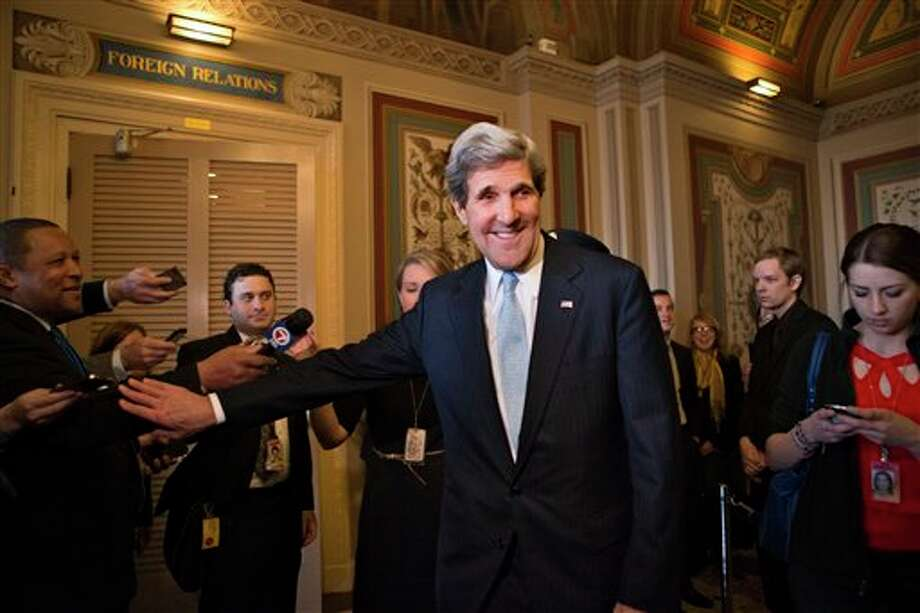 Sen. John Kerry, D-Mass., emerges after a unanimous vote by the Senate Foreign Relations Committee approving him to become America's next top diplomat, replacing Secretary of State Hillary Rodham Clinton, on Capitol Hill in Washington, Tuesday, Jan. 29, 2013. Kerry, who has served on the Foreign Relations panel for 28 years and led the committee for the past four, is expected to be swiftly confirmed by the whole Senate later Tuesday. (AP Photo/J. Scott Applewhite) Photo: J. Scott Applewhite / AP