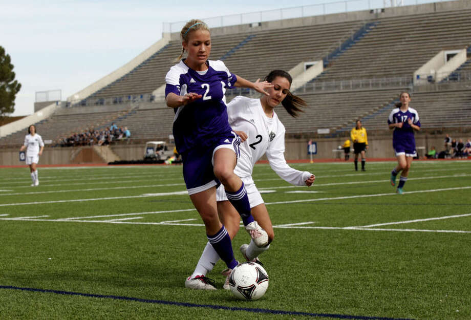 Midland High's Anne Bergman follows the ball out of bounds as Permian's Kelsey James tries to kick it back in bounds during the first half of the district 2-5A game, Saturday at Ratliff Stadium. The Lady Panthers lost to the Lady Dawgs 2-0. Photo: Edyta Blaszczyk | Odessa America