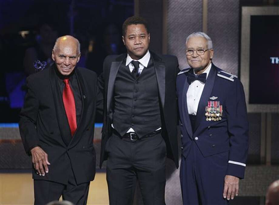 BET honorees Tuskegee Airmen, retired Air Force Col. Charles McGee, right, and Dr. Roscoe C. Brown Jr. speak after receiving the BET Honor for Service, with Cuba Gooding, Jr. during the BET Honors at the Warner Theatre in Washington on Jan. 14. McGee is one of two former Airmen who will appear at the CAF Saturday. Photo: AP Photo/Jose Luis Magana / FR159526 AP