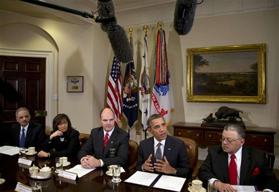 President Barack Obama speaks to media as he meets with representatives from Major Cities Chiefs Association and Major County Sheriffs Association in the Roosevelt Room of the White House, Monday, Jan. 28, 2013, in Washington, to discuss policies put forward by President Obama to reduce gun violence. From left are U.S. Attorney General Eric Holder, Minneapolis Police Chief Janee Harteau and Hennepin County Minnesota Sheriff Richard W. Stanek, President Obama, and Charles H. Ramsey Police Commissioner of the Philadelphia Police Department. (AP Photo/Carolyn Kaster) Photo: Carolyn Kaster / AP