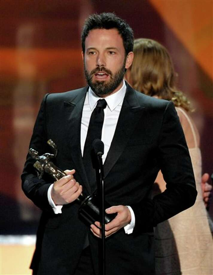 "Ben Affleck accepts the award for outstanding cast in a motion picture for ""Argo"" at the 19th Annual Screen Actors Guild Awards at the Shrine Auditorium in Los Angeles on Sunday Jan. 27, 2013. (Photo by John Shearer/Invision/AP) Photo: John Shearer / Invision"